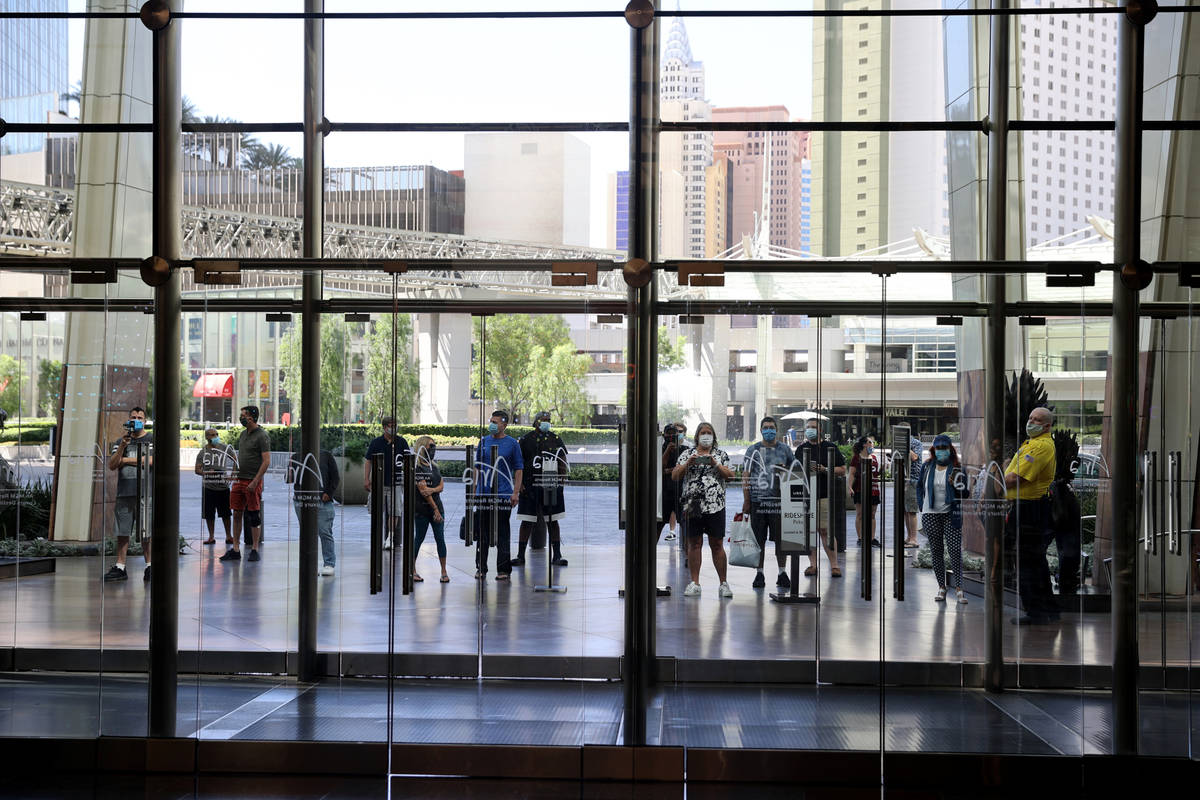 Guests wait outside Aria on the Strip in Las Vegas before reopening Wednesday, July 1, 2020. (K ...