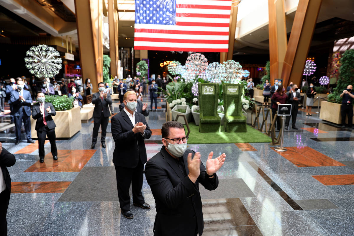 Aria employees, including Assistant Director of Catering Woody Saulter, applaud guests upon reo ...