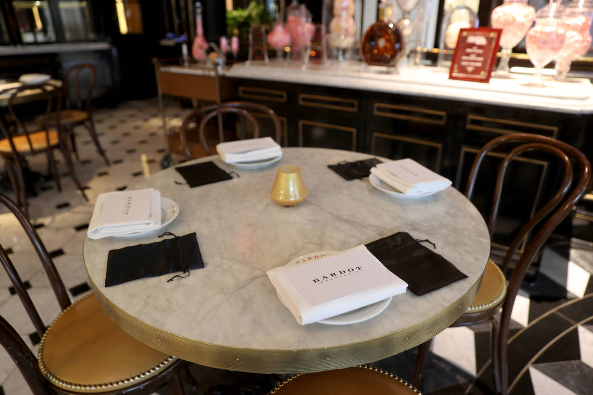 Bardot Brasserie table settings come with a mask bag at Aria on the Strip in Las Vegas upon reo ...