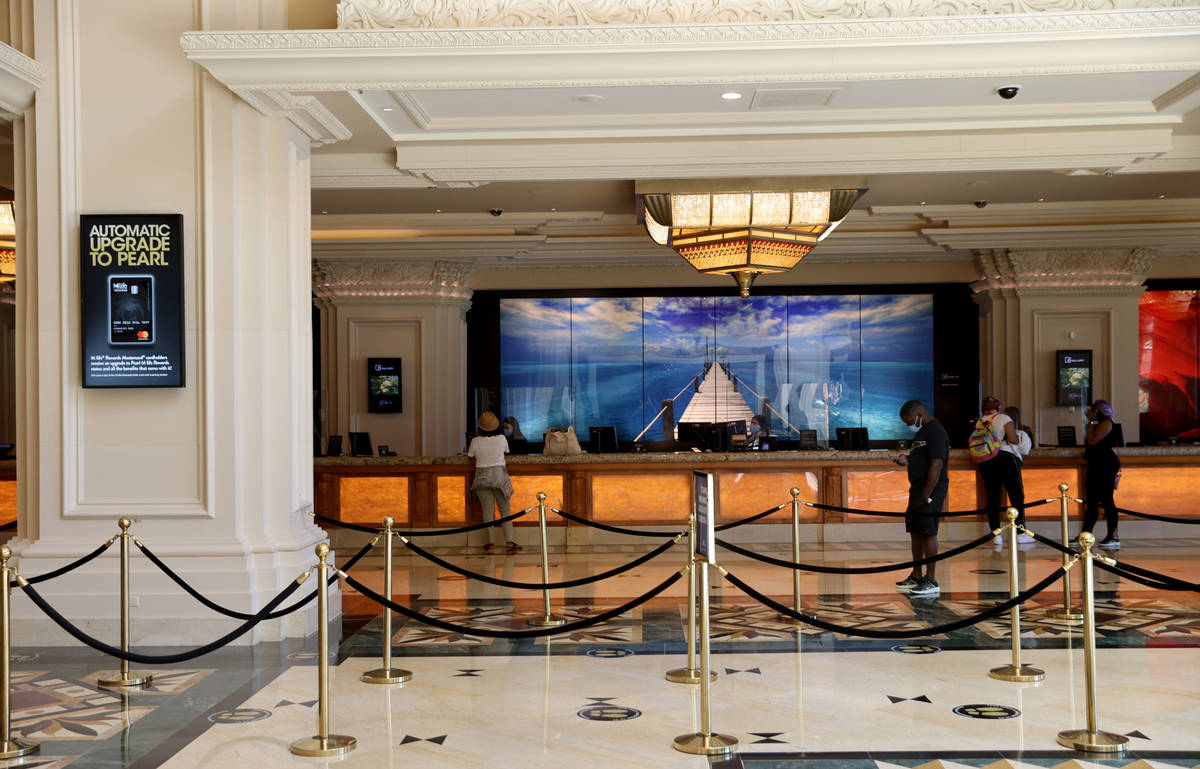 Guests check in Mandalay Bay on the Strip in Las Vegas upon reopening Wednesday, July 1, 2020. ...