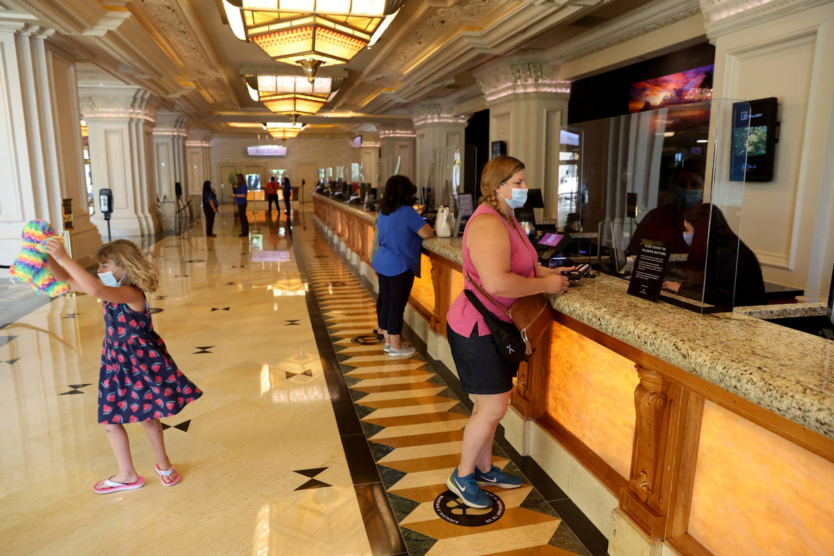Christine Folkes and her daughter Sierra, 7, of Sacramento, Calif. check in Mandalay Bay on the ...