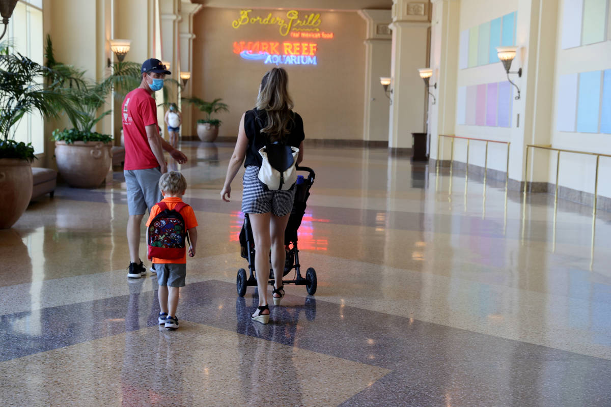 Guests walk to Shark Reef in Mandalay Bay on the Strip in Las Vegas upon reopening Wednesday, J ...