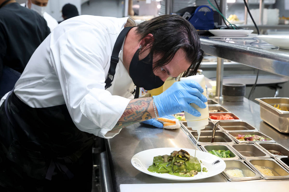Border Grill Executive Chef Mike Minor makes Chicken Poblano Enchiladas at Mandalay Bay on the ...