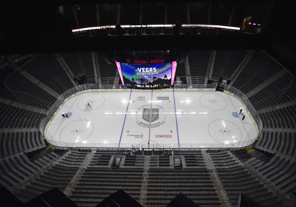 Workmen prepare the T-Mobile Arena ice before the start of an NHL hockey game between the Vegas ...