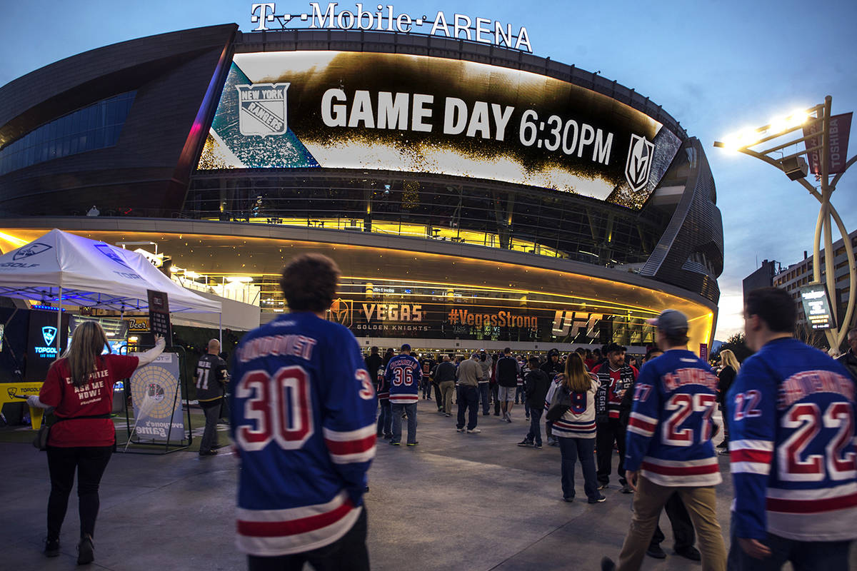 In this Jan. 7, 2018, file photo, New York Rangers fans arrive at T-Mobile Arena for an NHL hoc ...