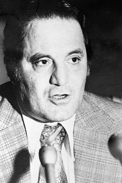 Portrait of Kansas City mob associate Joe Agosto speaking into a microphone. Location is unknow ...