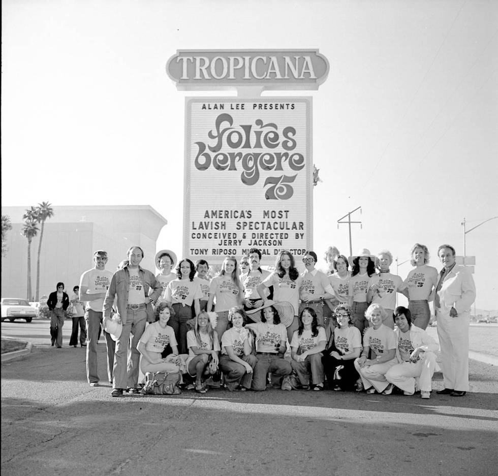 """The cast of """"Folies Bergere"""" pose under the marquee of the Tropicana hotel-casino Oct. 17, 1975 ..."""