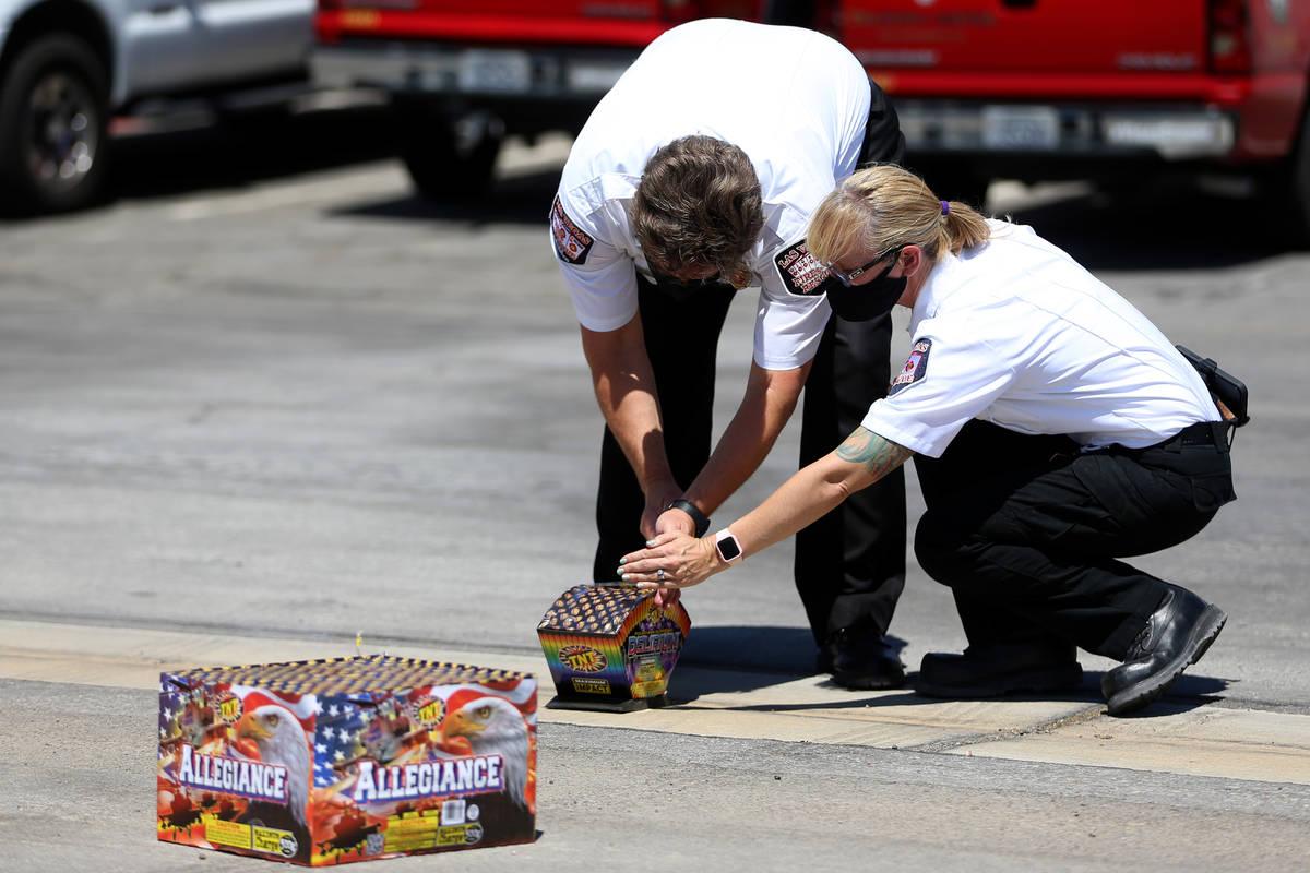 Las Vegas Fire and Rescue's fire inspectors Scott Thompson, left, and Melanie Dennon, give a de ...