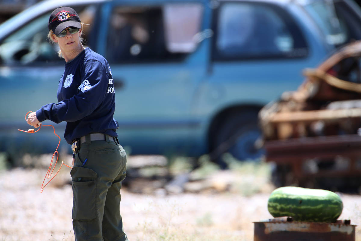 Laura Brown, senior bomb technician with Las Vegas Fire and Rescue, sets up a charge to blow up ...