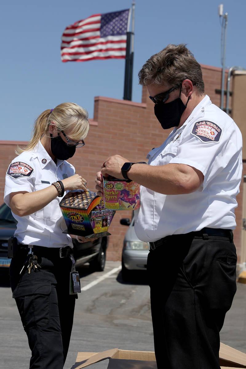 Las Vegas Fire and Rescue's fire inspectors Melanie Dennon, left, and Scott Thompson, give a de ...