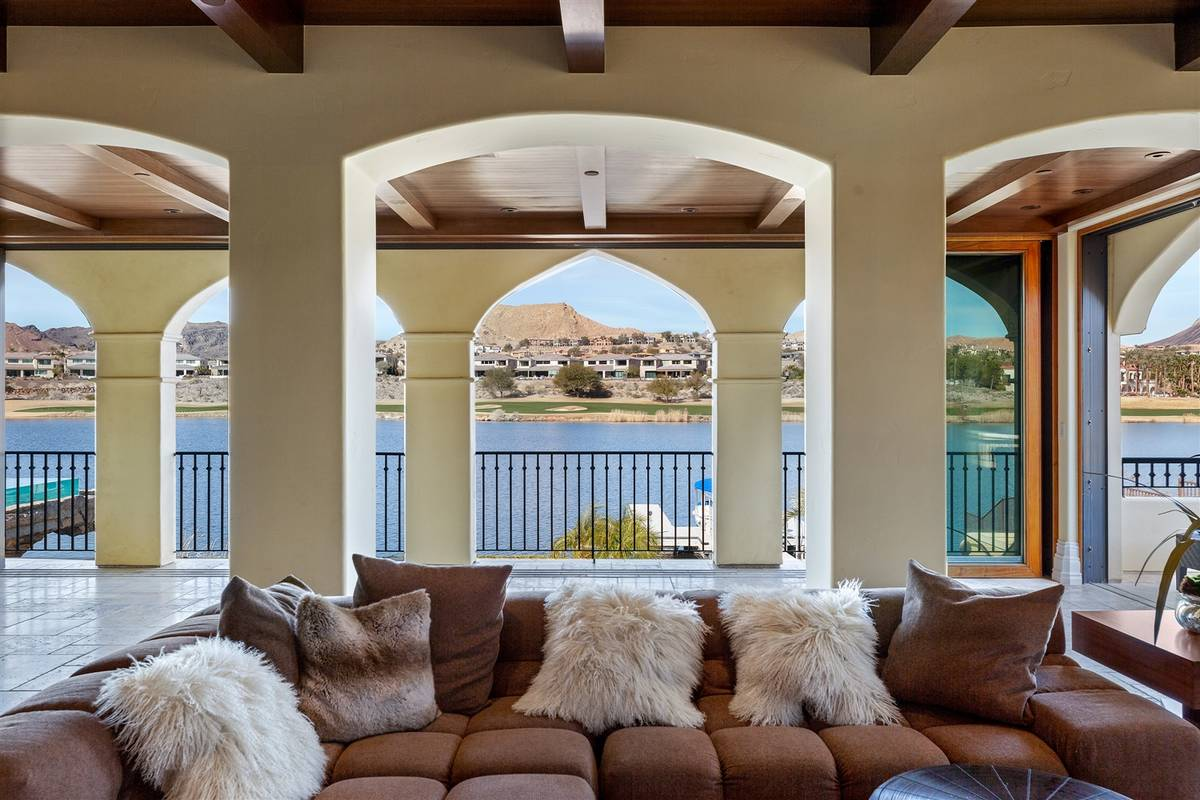 The family room has views of the lake. (Luxurious Real Estate)