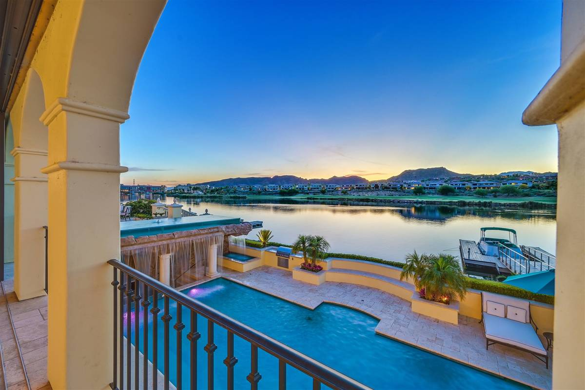 Luxurious Real Estate The three-level home at SouthShore Country Club has sweeping views of Lak ...