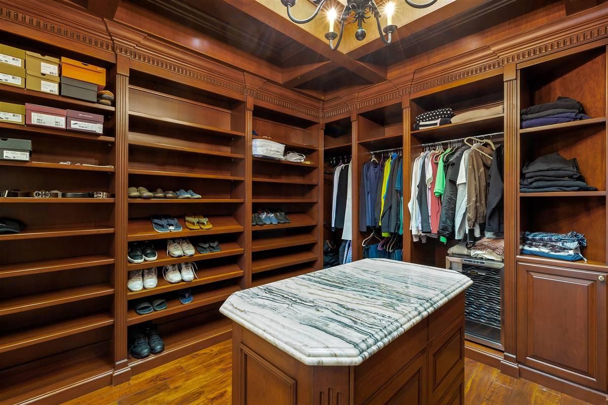 His closet. (Luxurious Real Estate)