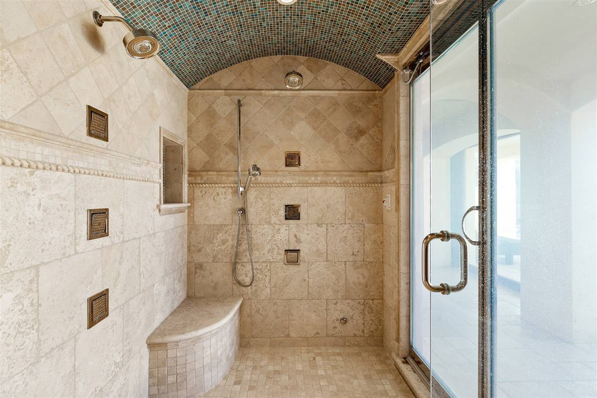Shower in guest bath. (Luxurious Real Estate)