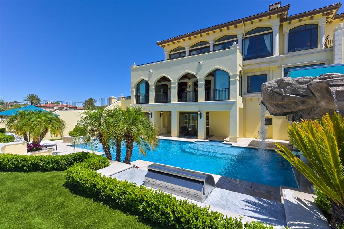 The three-story home features a large pool. (Luxurious Real Estate)