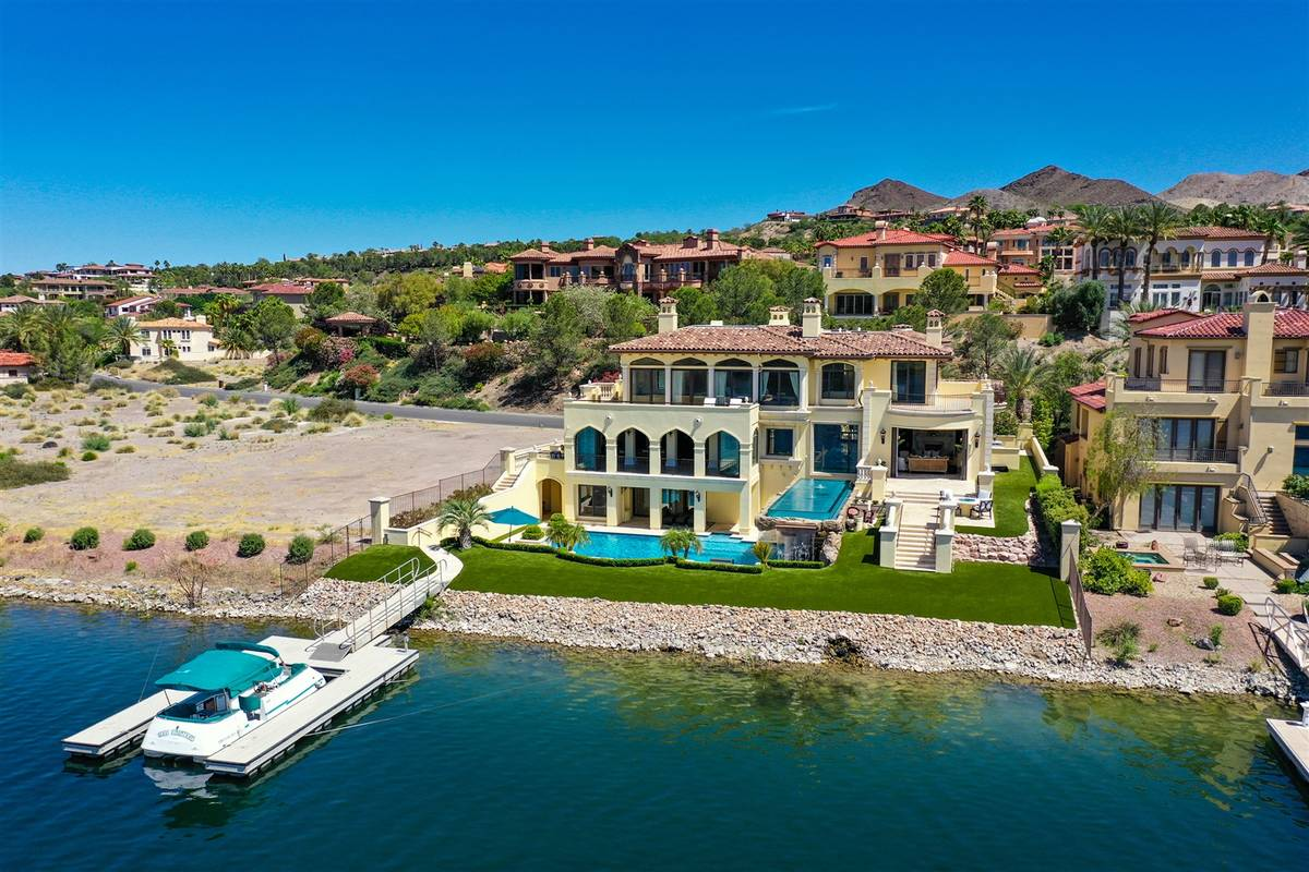 The three-level home has a two-level pool and boat dock. (Luxurious Real Estate)