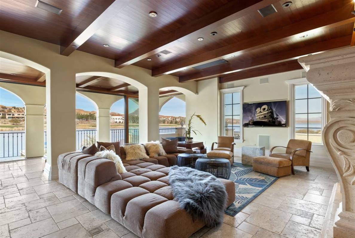 The family room is located on an upper level and has a full surround system and views of the la ...