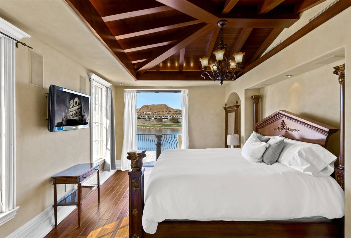 The main bedroom suite offers views of Lake Las Vegas and has a has an outdoor patio that wraps ...