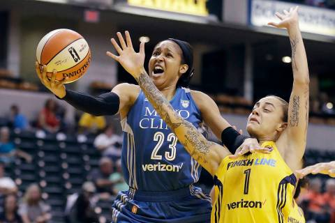 FILE - In this Aug. 30, 2017, file photo, Minnesota Lynx's Maya Moore, left, shoots against Ind ...