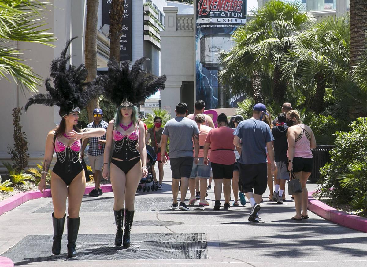 Tourists walk along Las Vegas Boulevard near the Flamingo on Friday, July 3, 2020, in Las Vegas ...