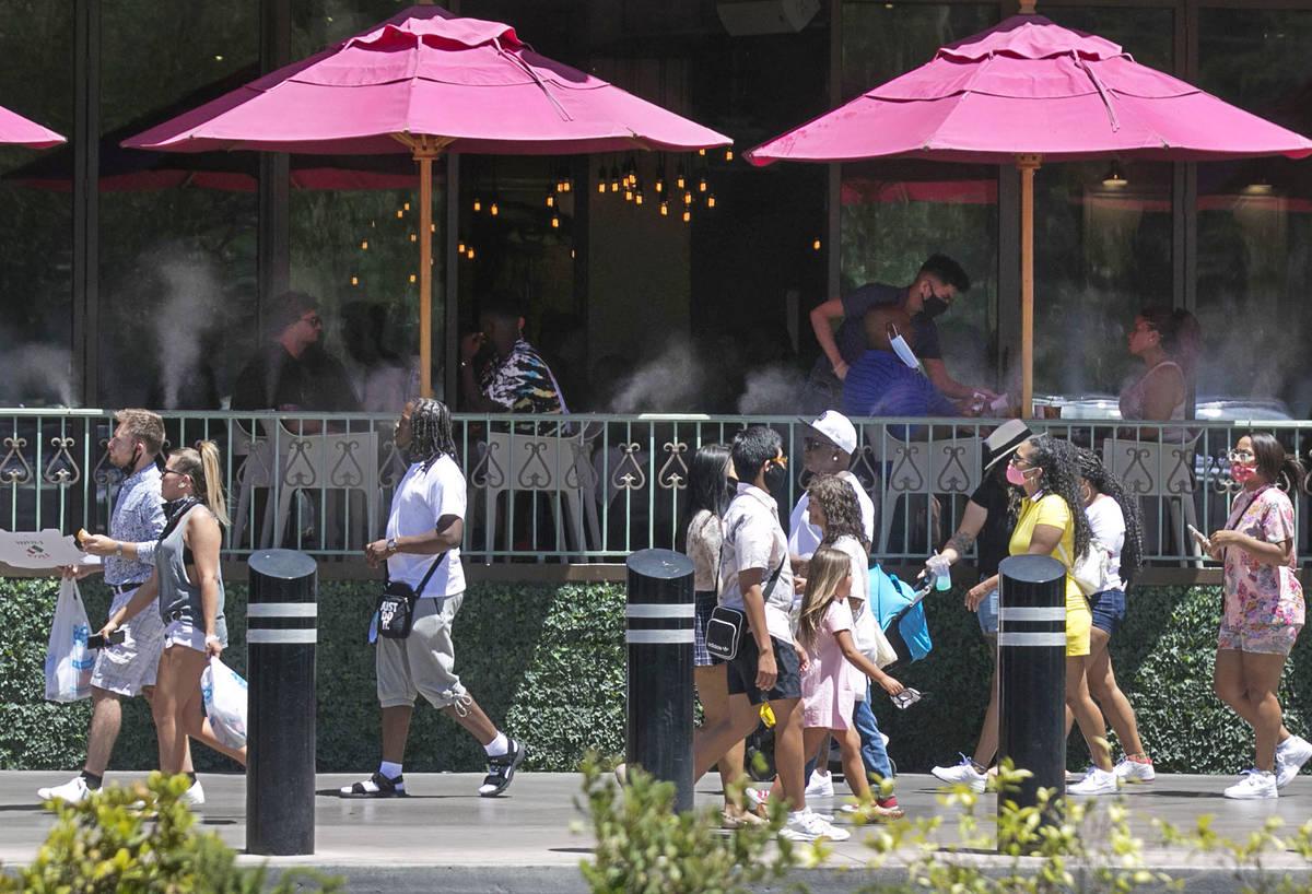 Tourists walk along Las Vegas Boulevard on Friday, July 3, 2020, in Las Vegas. (Bizuayehu Tesfa ...