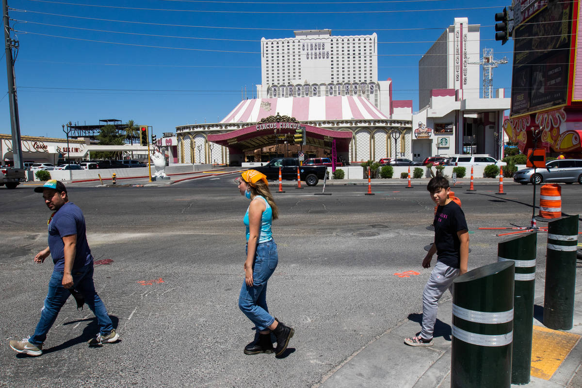 People walk in the crosswalk in front of Circus Circus in Las Vegas on Friday, July 3, 2020. (C ...