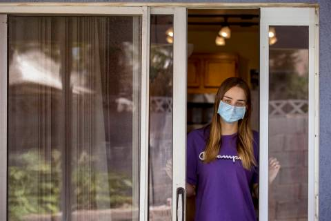 Kaydee Asher, 16, socially distanced at her back door, is currently fighting the coronavirus an ...