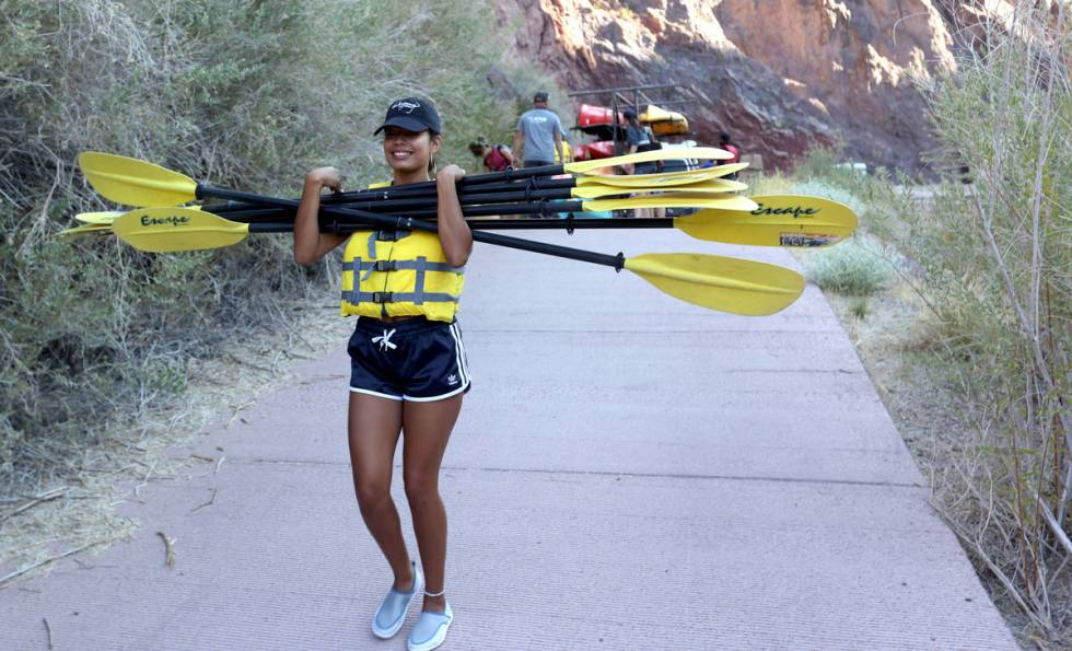 Ashia Paez of New York prepares for a day of kayaking in Black Canyon at the base of the Hoover ...