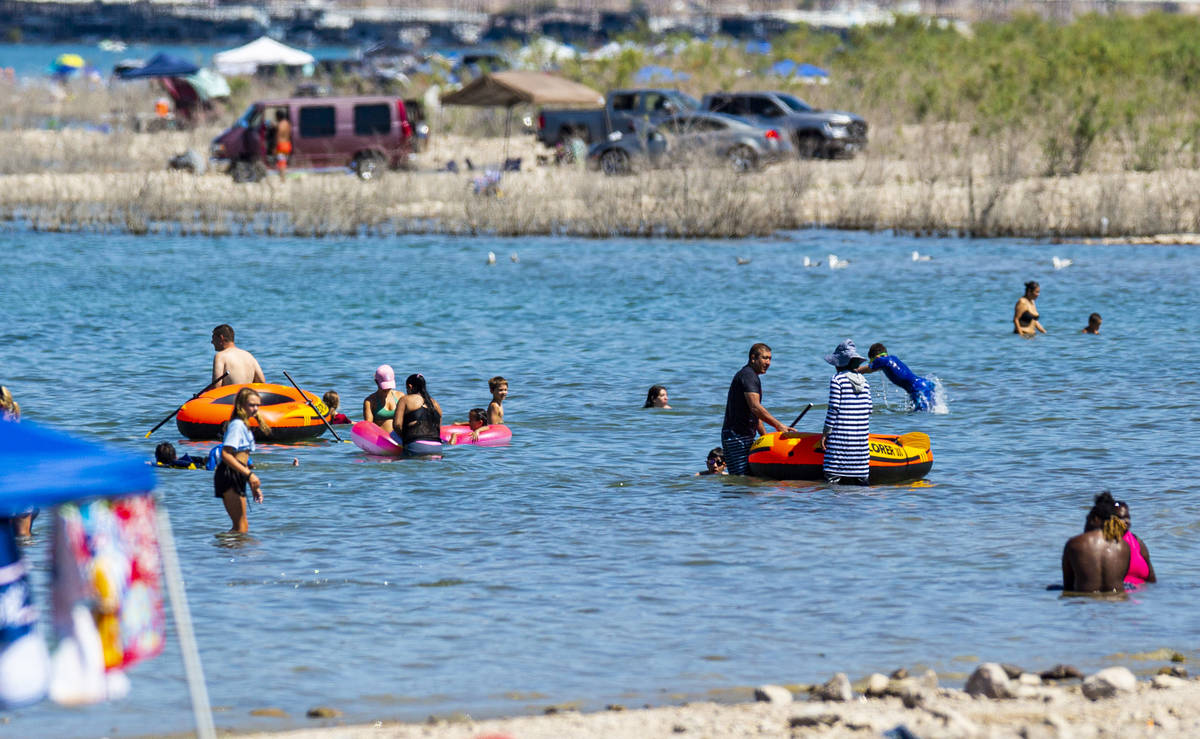 People relax in the water at Boulder Beach at Lake Mead National Recreation Area on Wednesday, ...