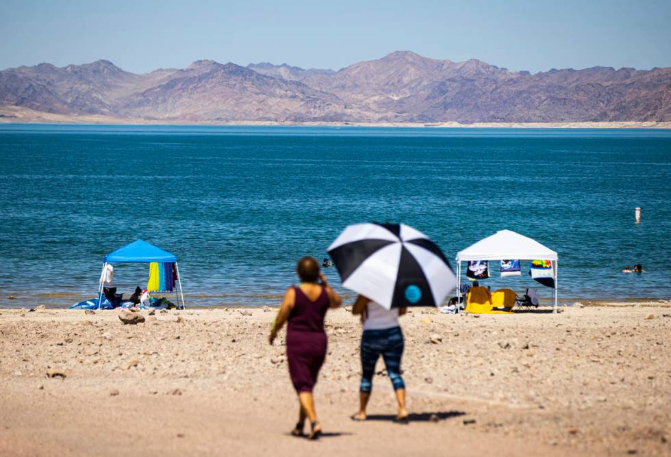 People walk to Boulder Beach at Lake Mead National Recreation Area on Wednesday, July 29, 2020. ...