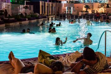In this June 5, 2017, file photo, pool goers enjoy a showing of Happy Gilmore during Dive in Mo ...