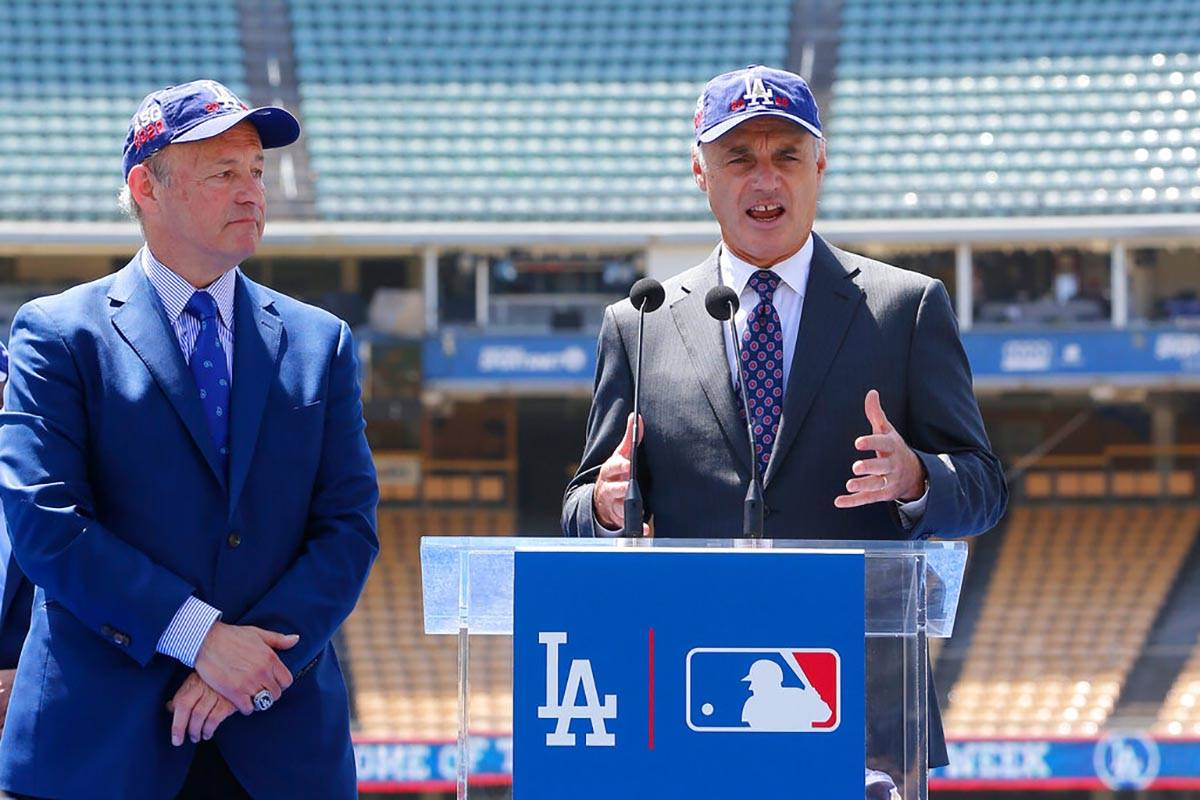 FILE - In this April 11, 2018, file photo, Los Angeles President and CEO Stan Kasten, left, and ...