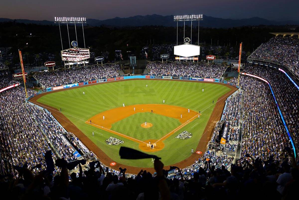 In this Oct. 25, 2017, file photo, the Houston Astros and the Los Angeles Dodgers play in Game ...