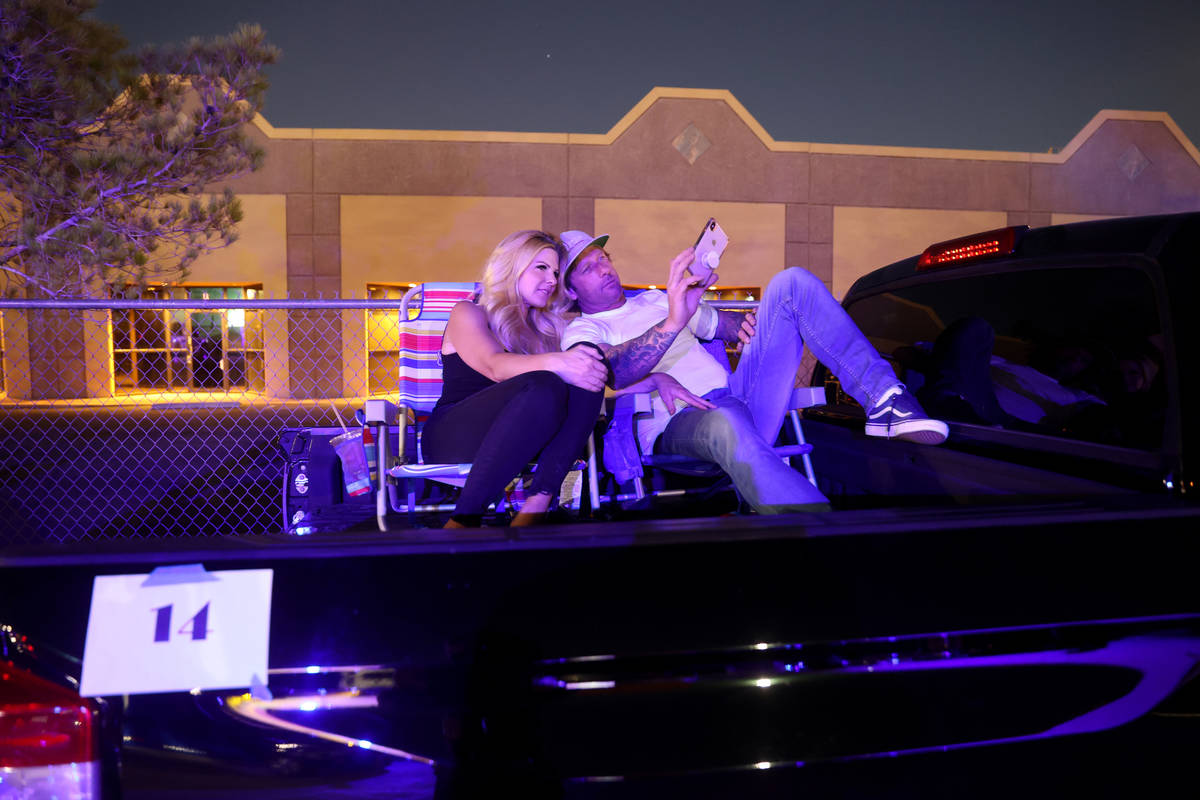 """Brittney Kelley and Ryan Good of Las Vegas watch the pre-show before Jennifer Romas' """"Sexxy The ..."""