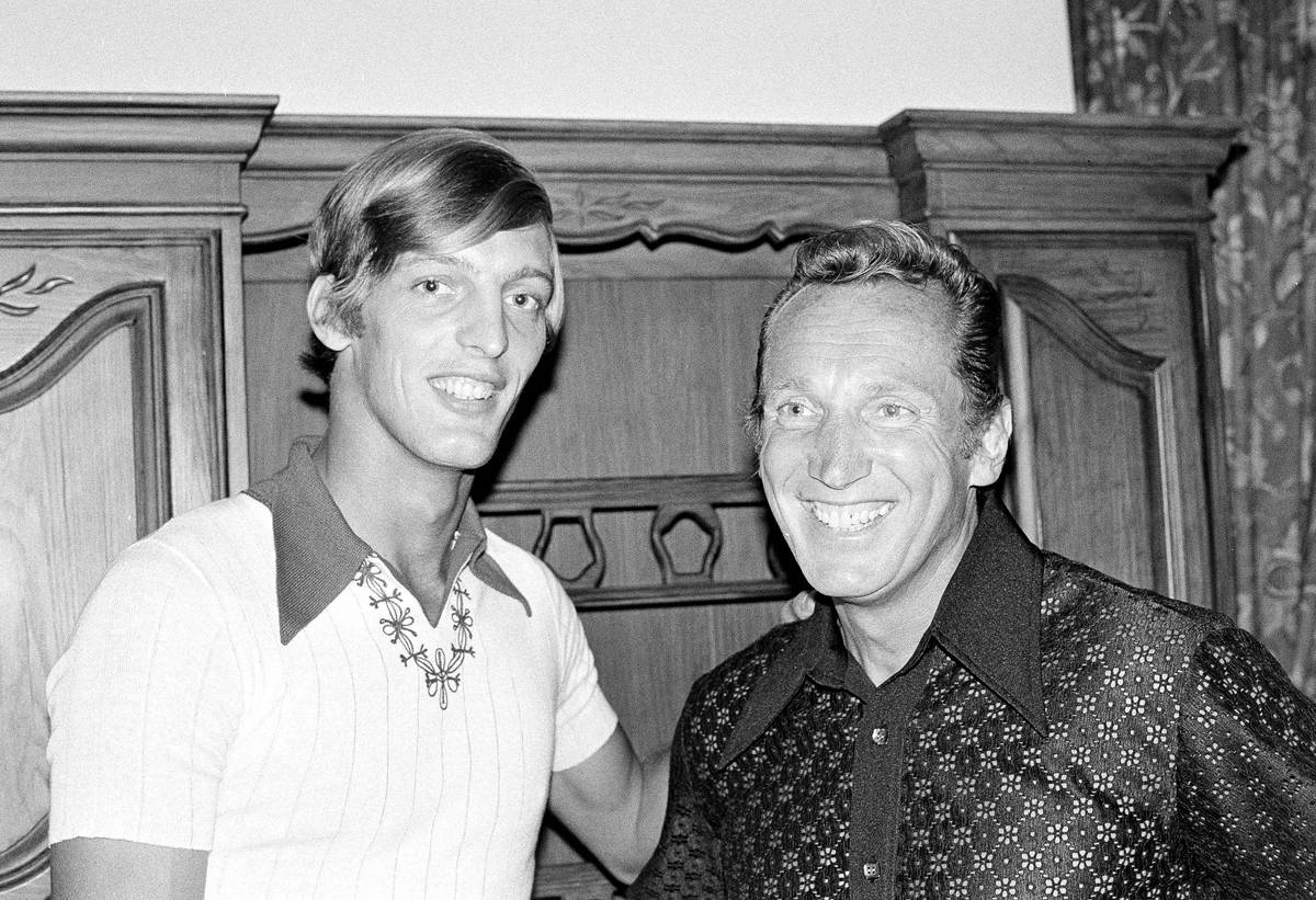 Ray Guy, left, of Thomson, Ga., and graduate of the University of Southern Mississippi, poses w ...