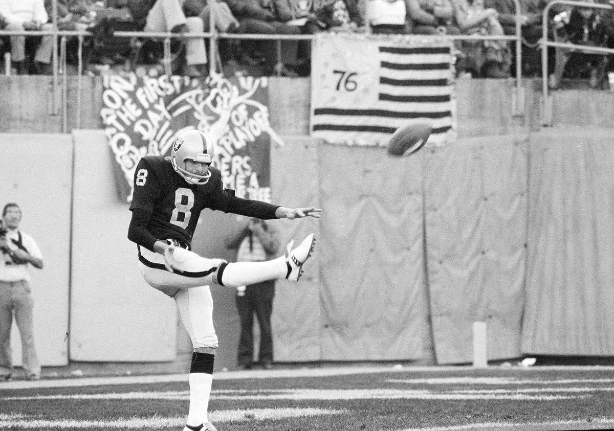 Ray Guy (8), Oakland Raiders punting specialist, booms one in a recent game in 1976. (AP Photo)