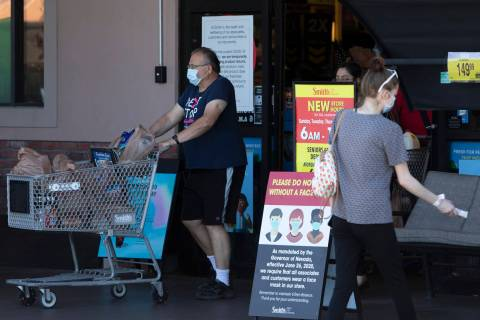 Customers enter and exit the Smith's Food & Drug on West Charleston Boulevard ahead of Inde ...