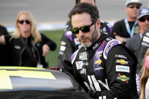 FILE - In this Feb. 16, 2020 file photo Jimmie Johnson climbs intp his car before the NASCAR Da ...