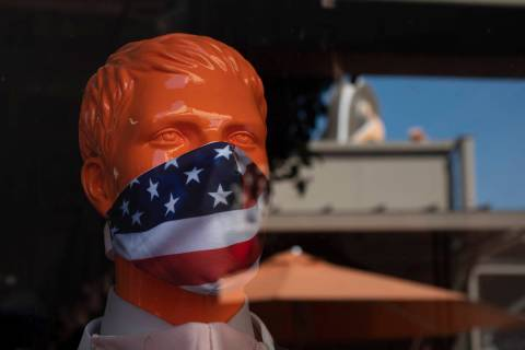 A mannequin wears a face mask at the Citadel Outlets in Commerce, Calif., Thursday, July 2, 202 ...
