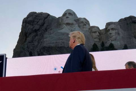 President Donald Trump watches as planes perform fly-overs of the Mount Rushmore National Monum ...