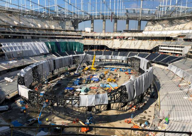 In this Jan. 22, 2020, file photo, works continues on the interior of SoFi Stadium and preparin ...