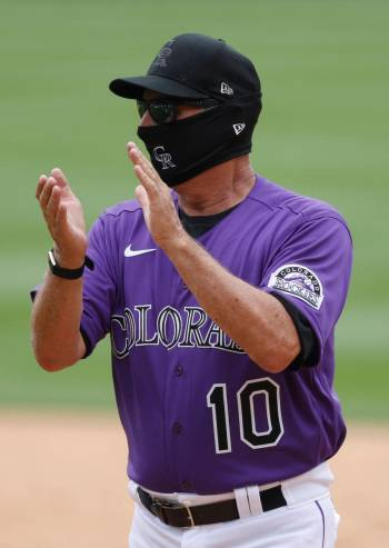 Colorado Rockies manager Bud Black claps as the team practices in Coors Field Saturday, July 4, ...