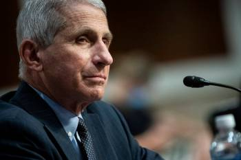 Director of the National Institute of Allergy and Infectious Diseases Dr. Anthony Fauci listens ...