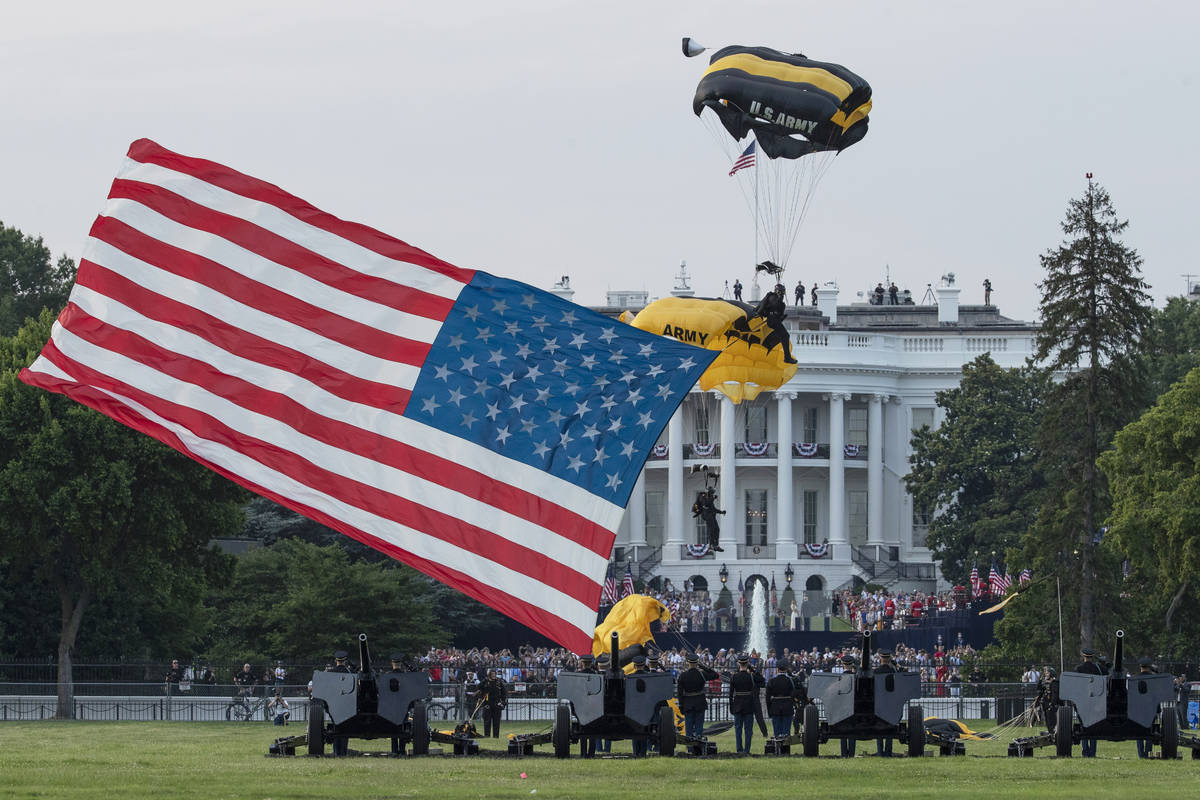 President Donald Trump and first lady Melania Trump watch as the U.S. Army Golden Knights Parac ...