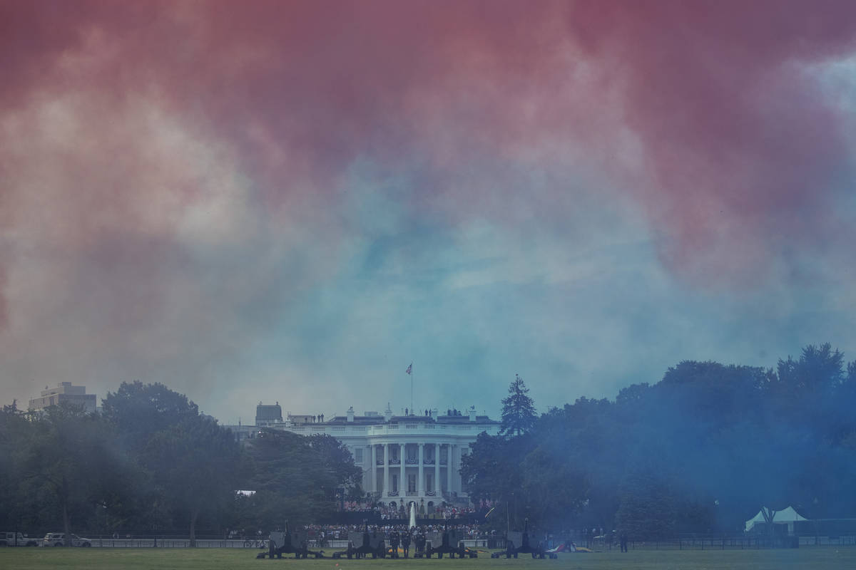 "The White House in obscured by Red and Blue smoke floating on the Ellipse during a ""Salute ..."