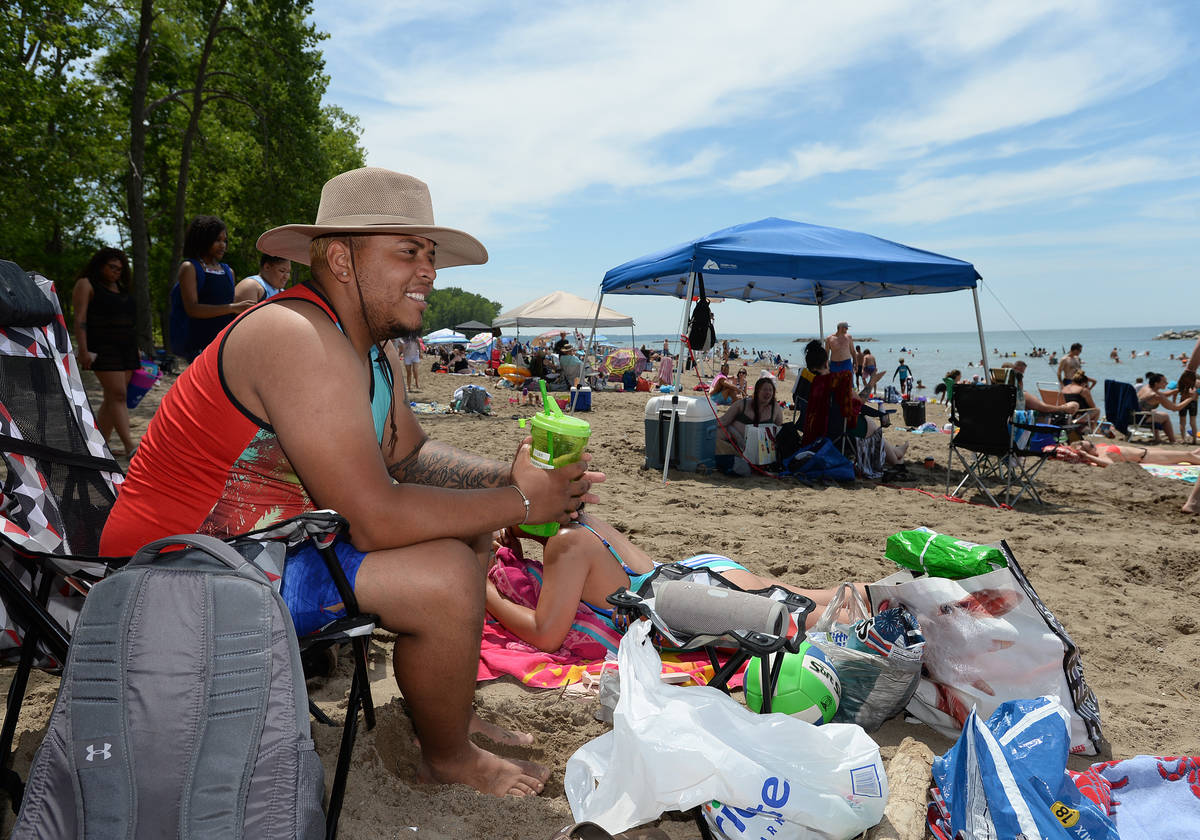 Jomar Gomez, 25, of Jamestown, N.Y., spends time for the July Fourth weekend at Beach 6, Presqu ...