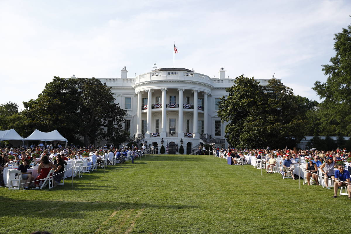 "Guests wait for President Donald Trump and first lady Melania Trump during a ""Salute to Am ..."