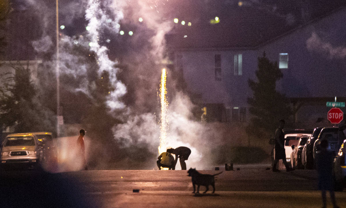 People set off fireworks along Desert Palm Drive in Las Vegas on Saturday, July 4, 2020. (Chase ...