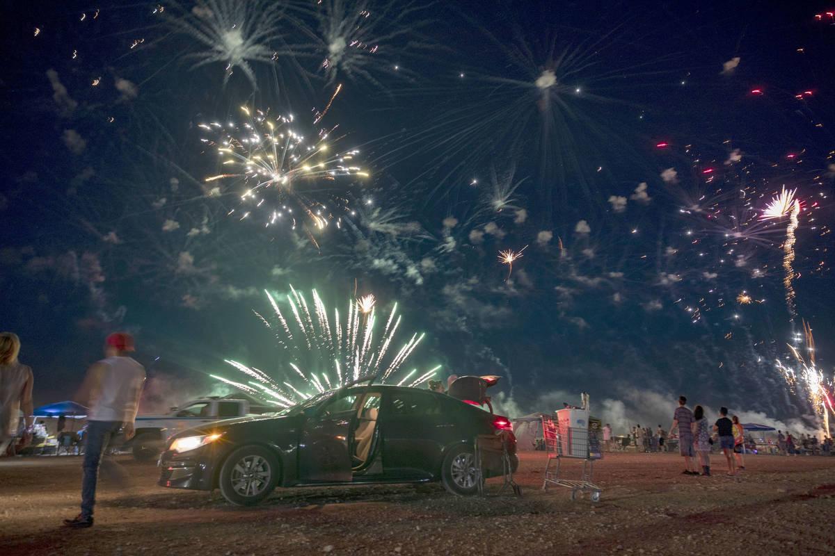 Fireworks explode near Moapa Paiute Travel Plaza during Fourth of July festivities in Moapa, Ne ...