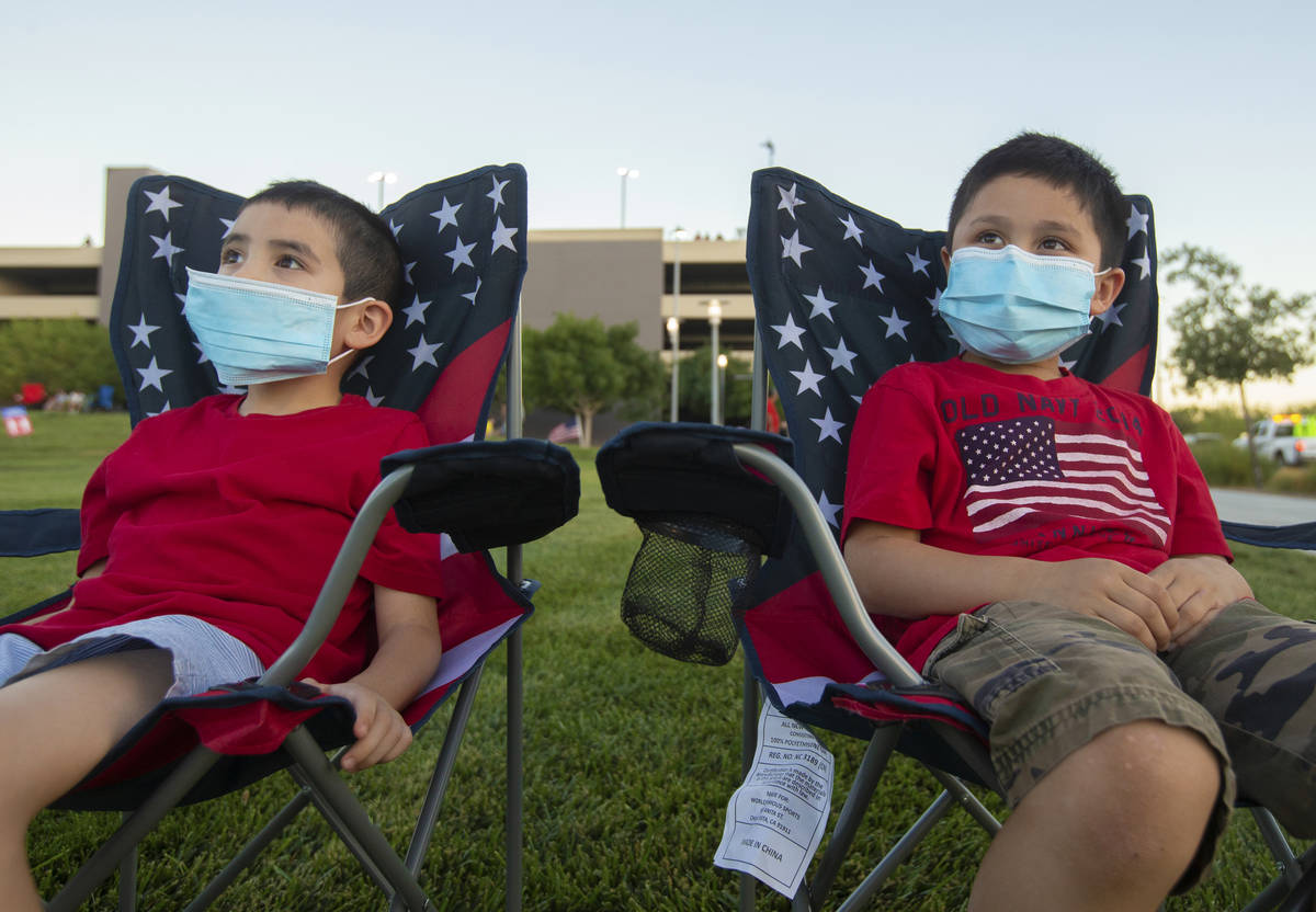 James Watson, left, 7, and brother Thomas, 6, wait for the start of the Red Rock Casino firewor ...